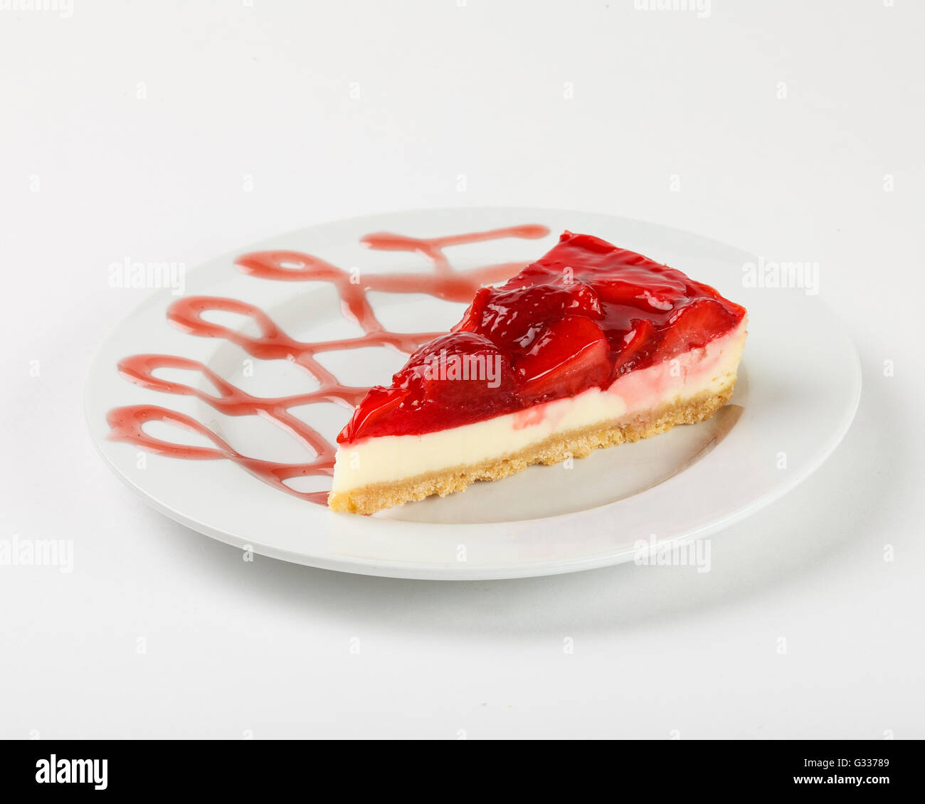 Cheesecake with strawberry jelly. Close up side view. - Stock Image