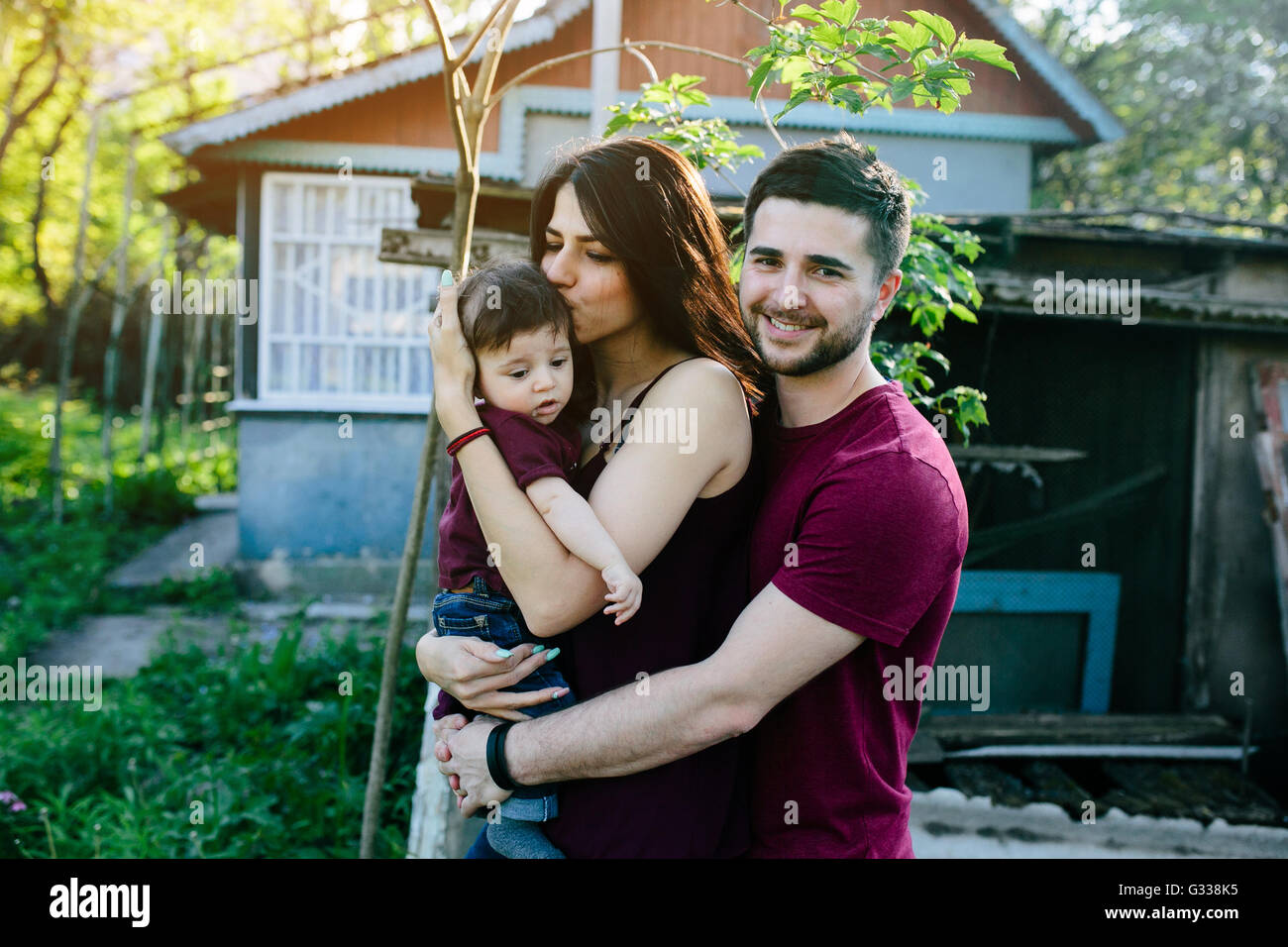 young family with a child on the nature - Stock Image