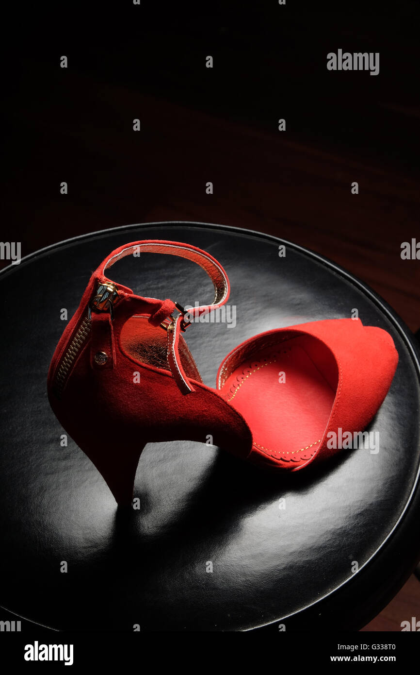 Red High-heel shoes by Australian designer Alannah Hill - Stock Image