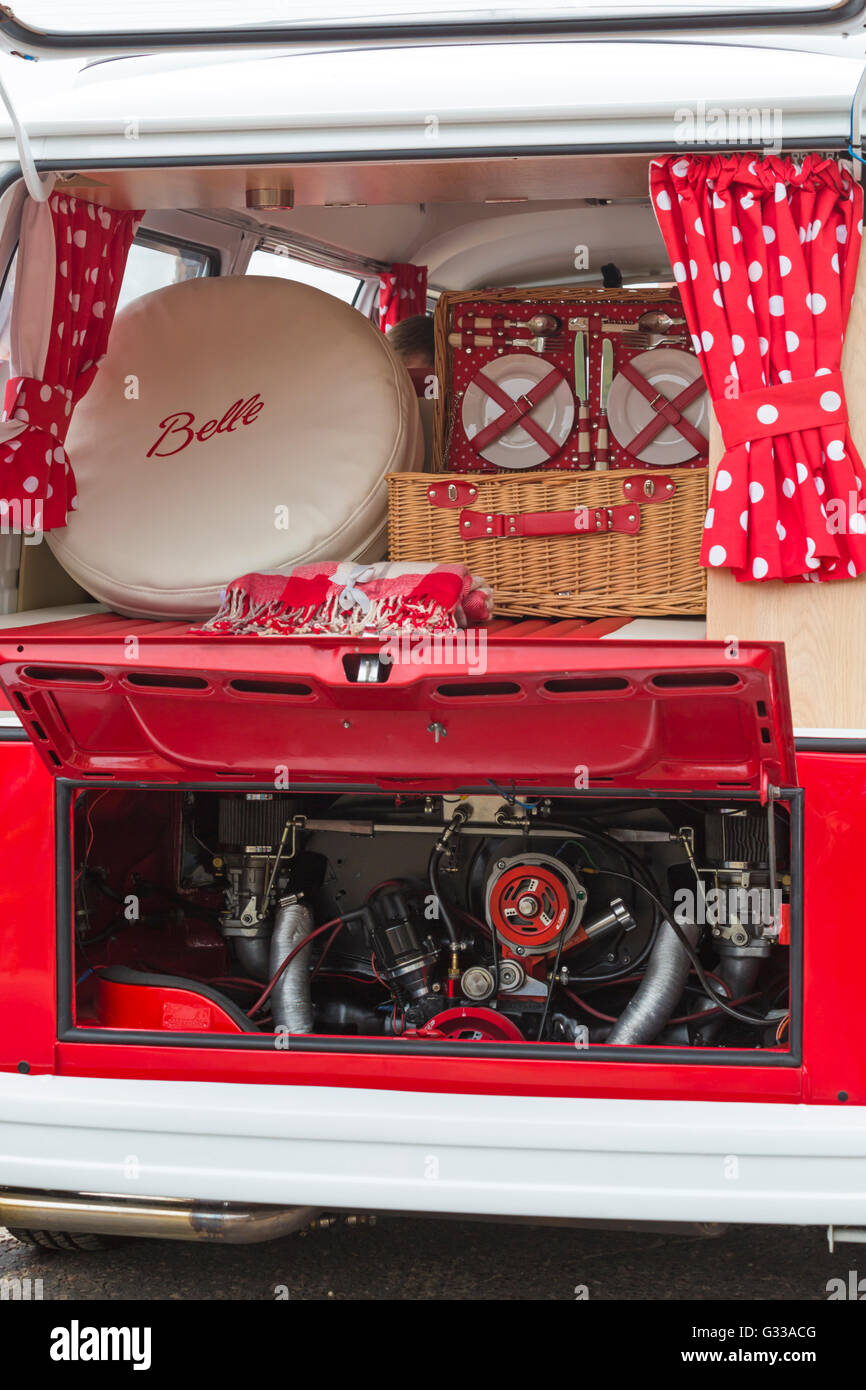 Items on display in red VW campervan and showing engine at Bournemouth Wheels Festival in June - Stock Image