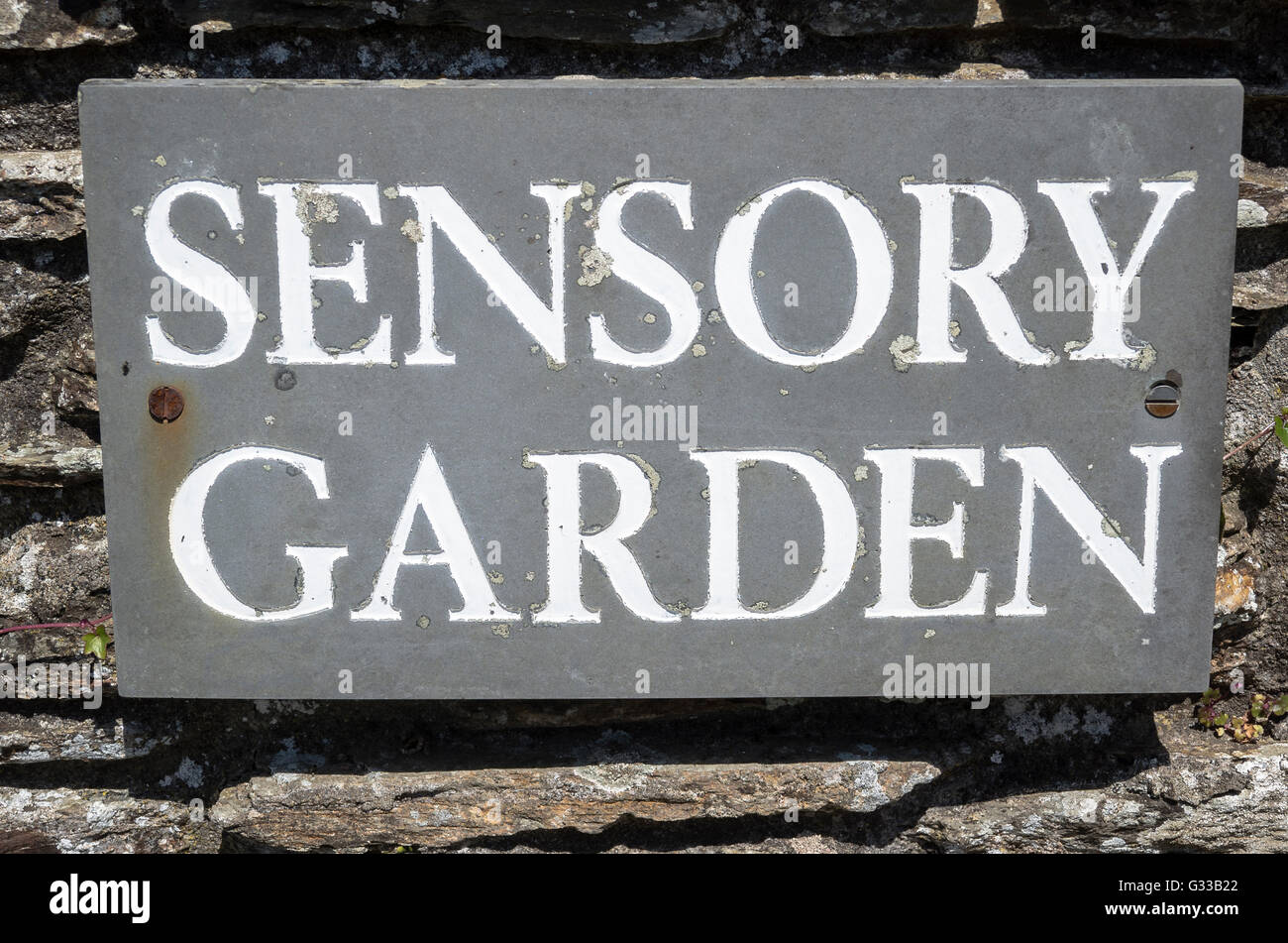 Identifying sign signifying a specific small garden as 'Sensory' for the benefit of disabled or visually impaired Stock Photo