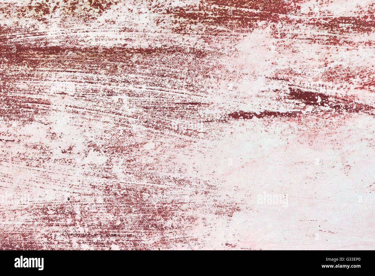 Close view of the deep red paint on the bottom of a boat that has been worn off. - Stock Image