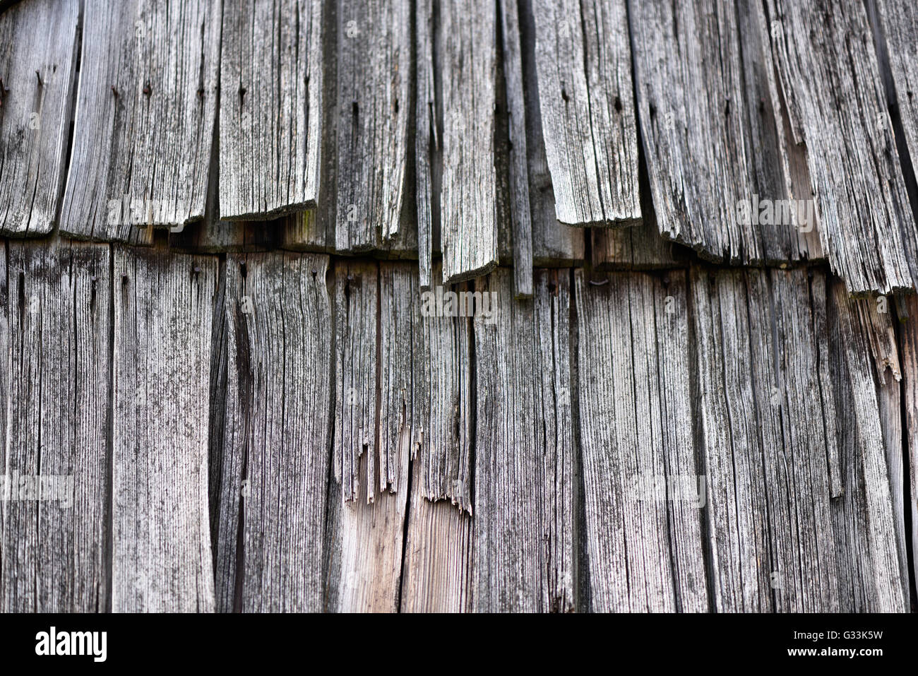 Obsolete wood planks from an old house roof - Stock Image