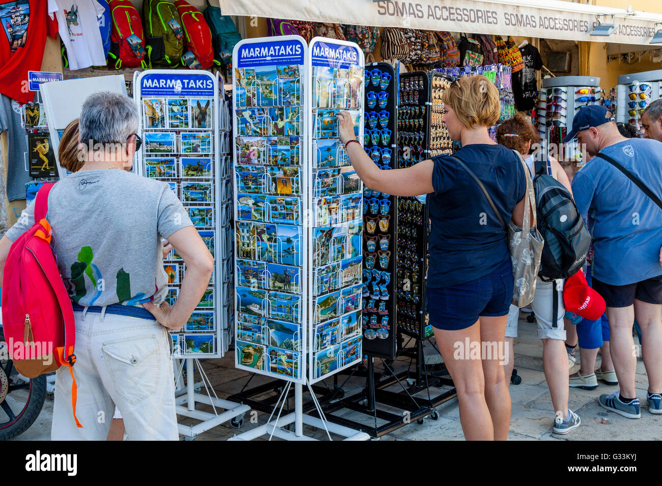 Tourists Choosing Postcards At A Souvenir Shop In Corfu Old Town, Corfu, Greece - Stock Image