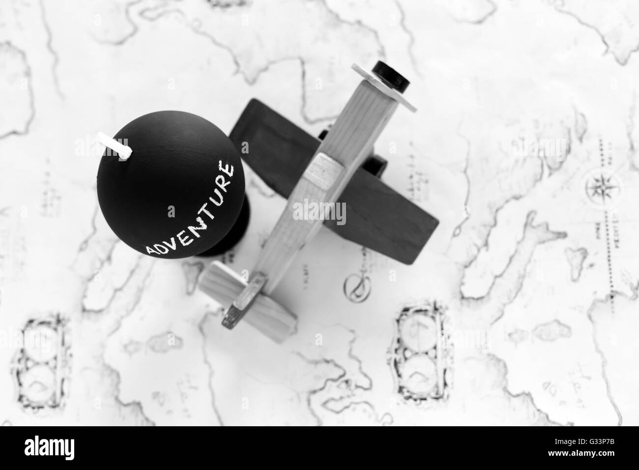 Globe and airplane toy with copy space - Stock Image
