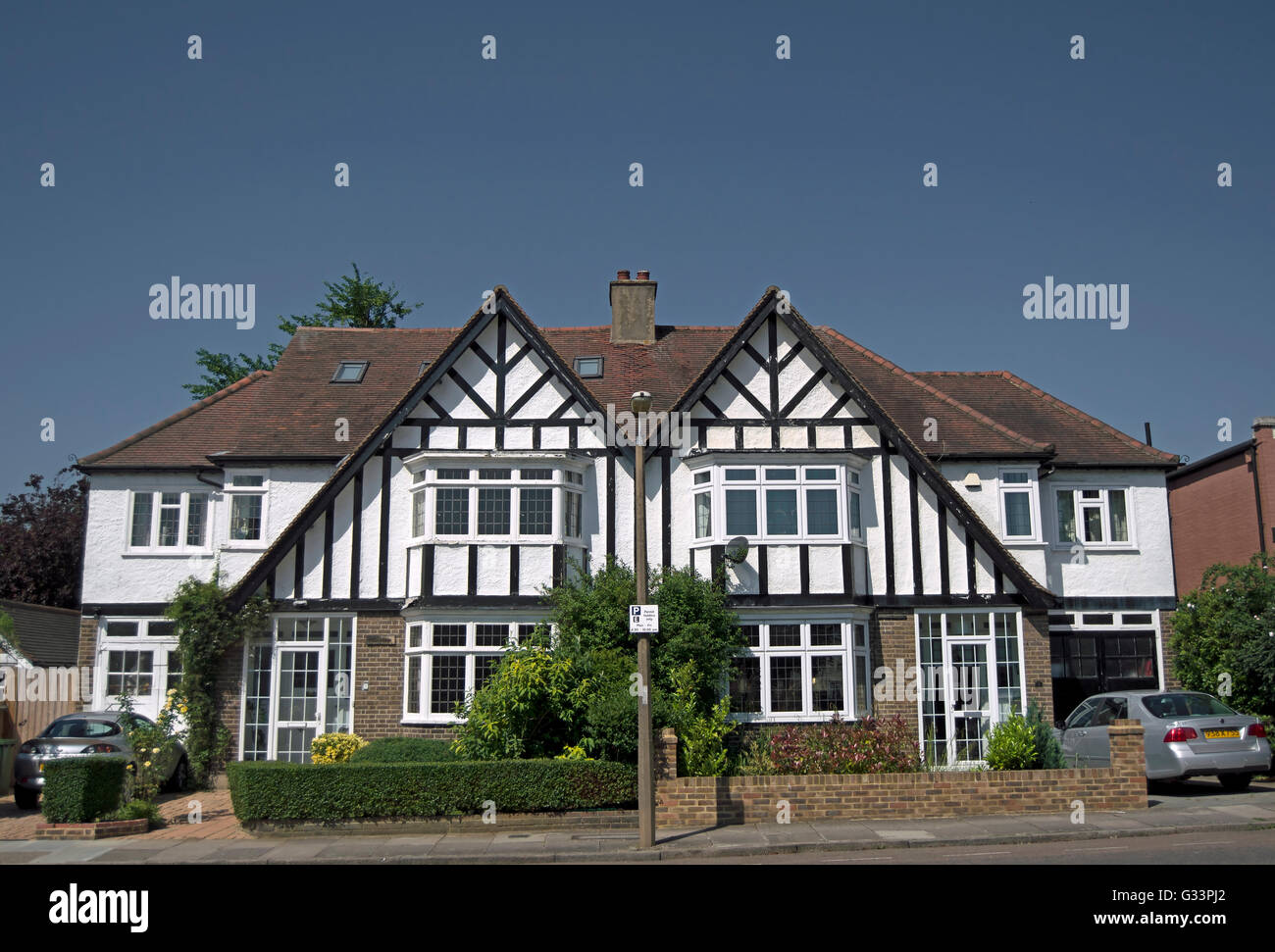 matching semi-detached mock tudor houses in strawberry hill, twickenham, middlesex, england - Stock Image