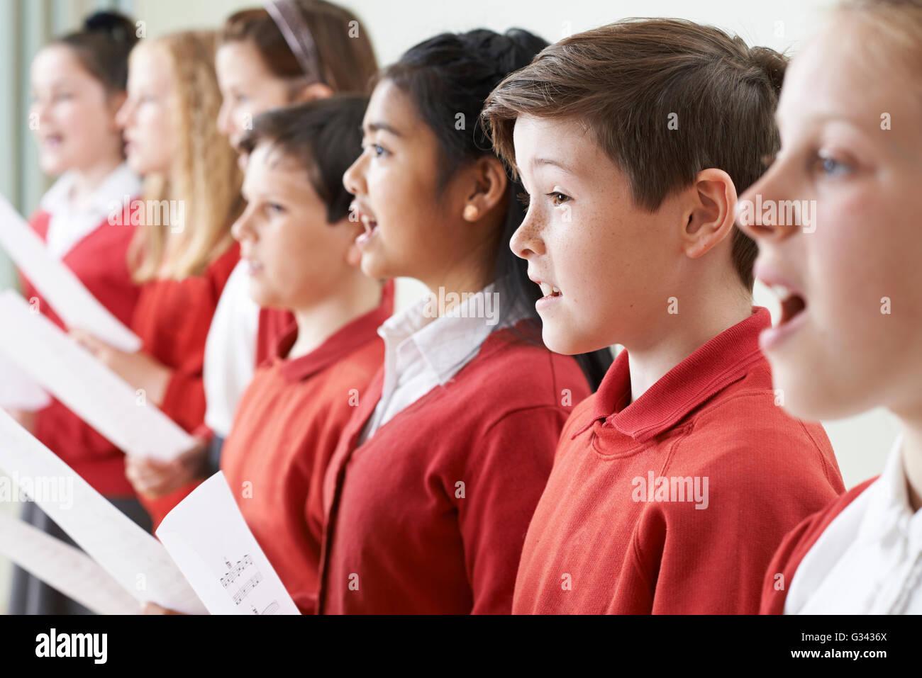 Group Of Children Singing In School Choir - Stock Image
