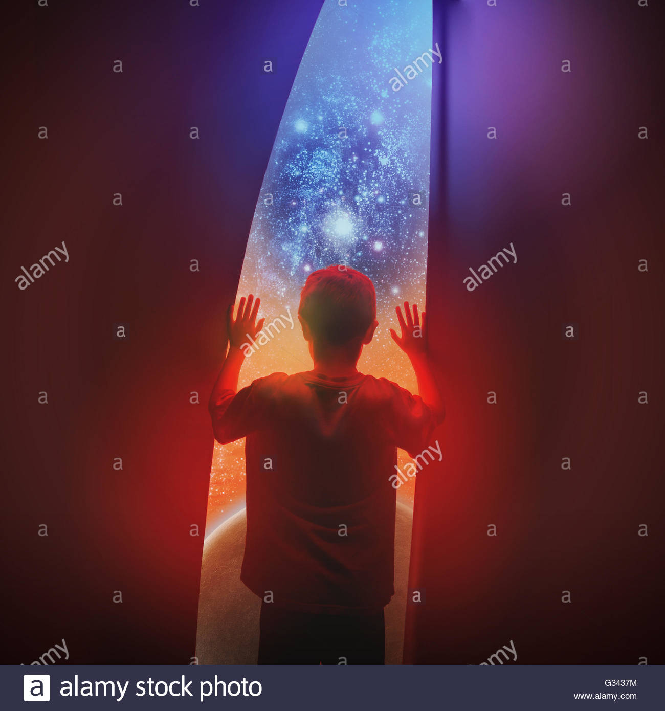 A space boy is looking out a window with stars and a galaxy planet for a exploration or science concept. - Stock Image