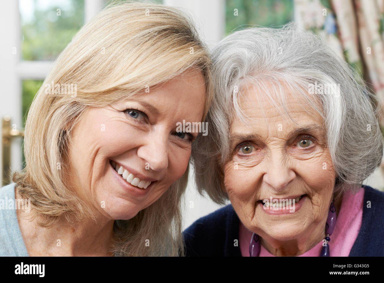 Portrait Of Senior Mother And Adult Daughter - Stock Image