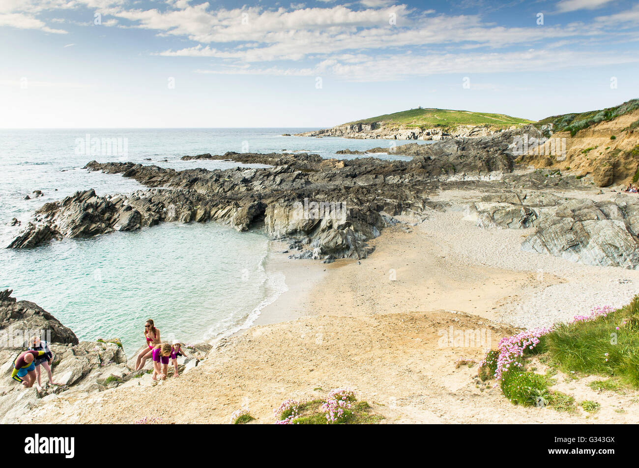 Little Fistral Holidaymakers enjoy the sunny weather at Little Fistral Newquay, Cornwall. - Stock Image