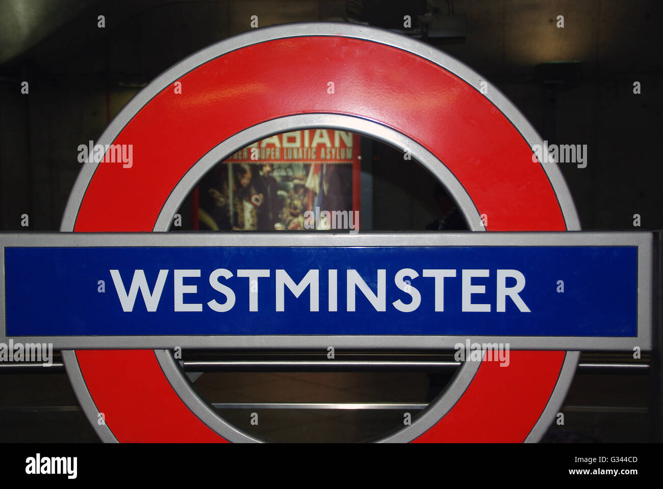 Westminster sign on London underground with museum poster in background - Stock Image