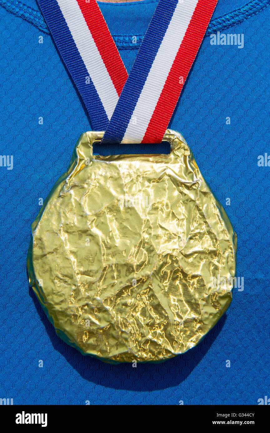 Gold medal hanging from USA colors red, white, and blue