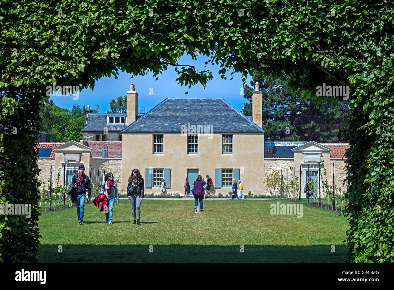 The view through the beech hedge looking towards the newly restored Botanic Cottage in the Botanic Gardens in Edinburgh. - Stock Image