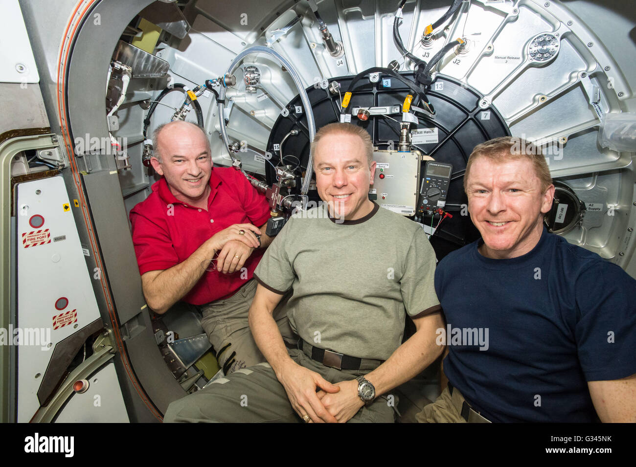 International Space Station Expedition 47 NASA astronauts Jeff Williams, left, Timothy Kopra, center, and  ESA astronaut - Stock Image