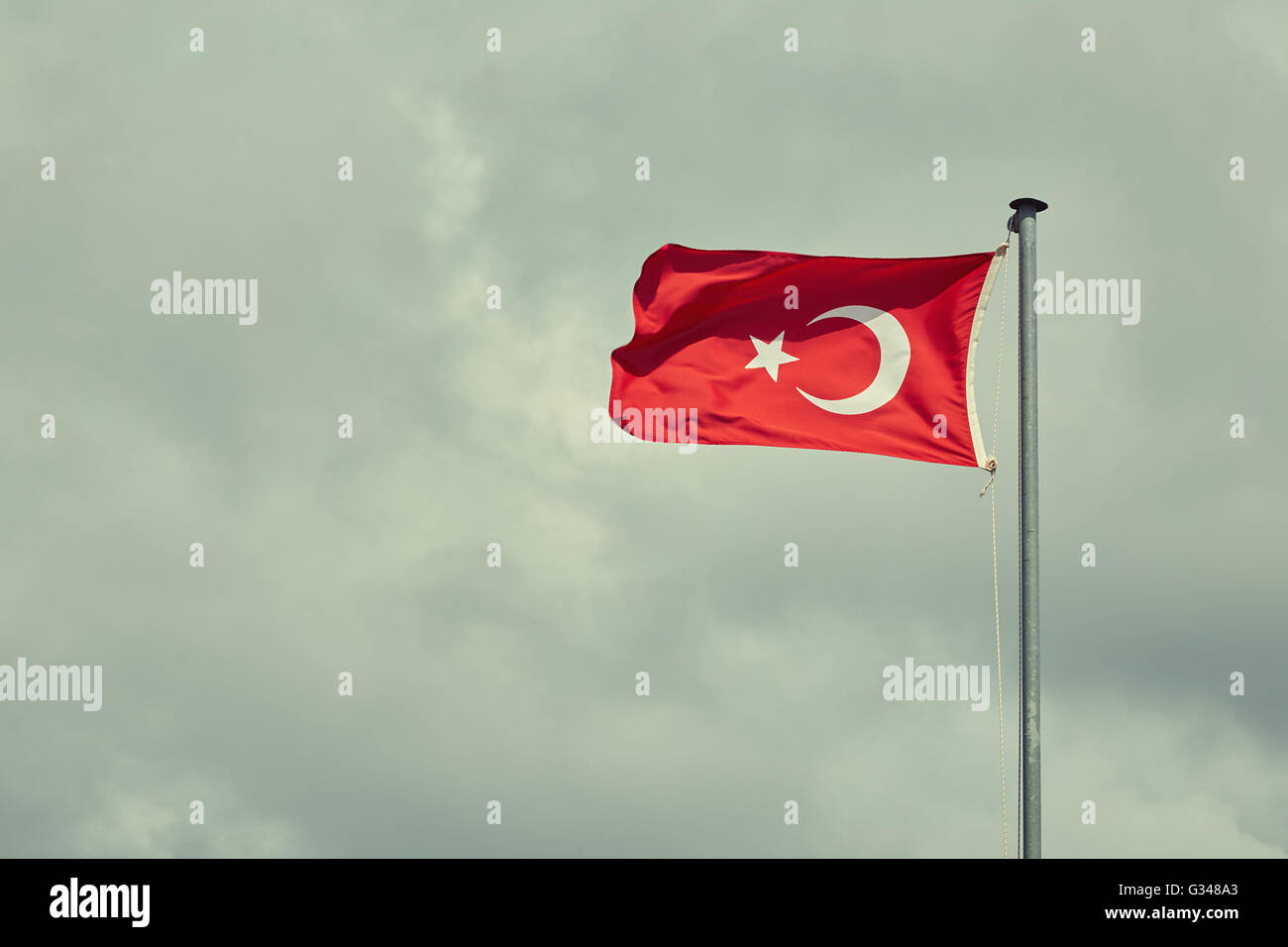 Turkish flag blowing in the wind. - Stock Image