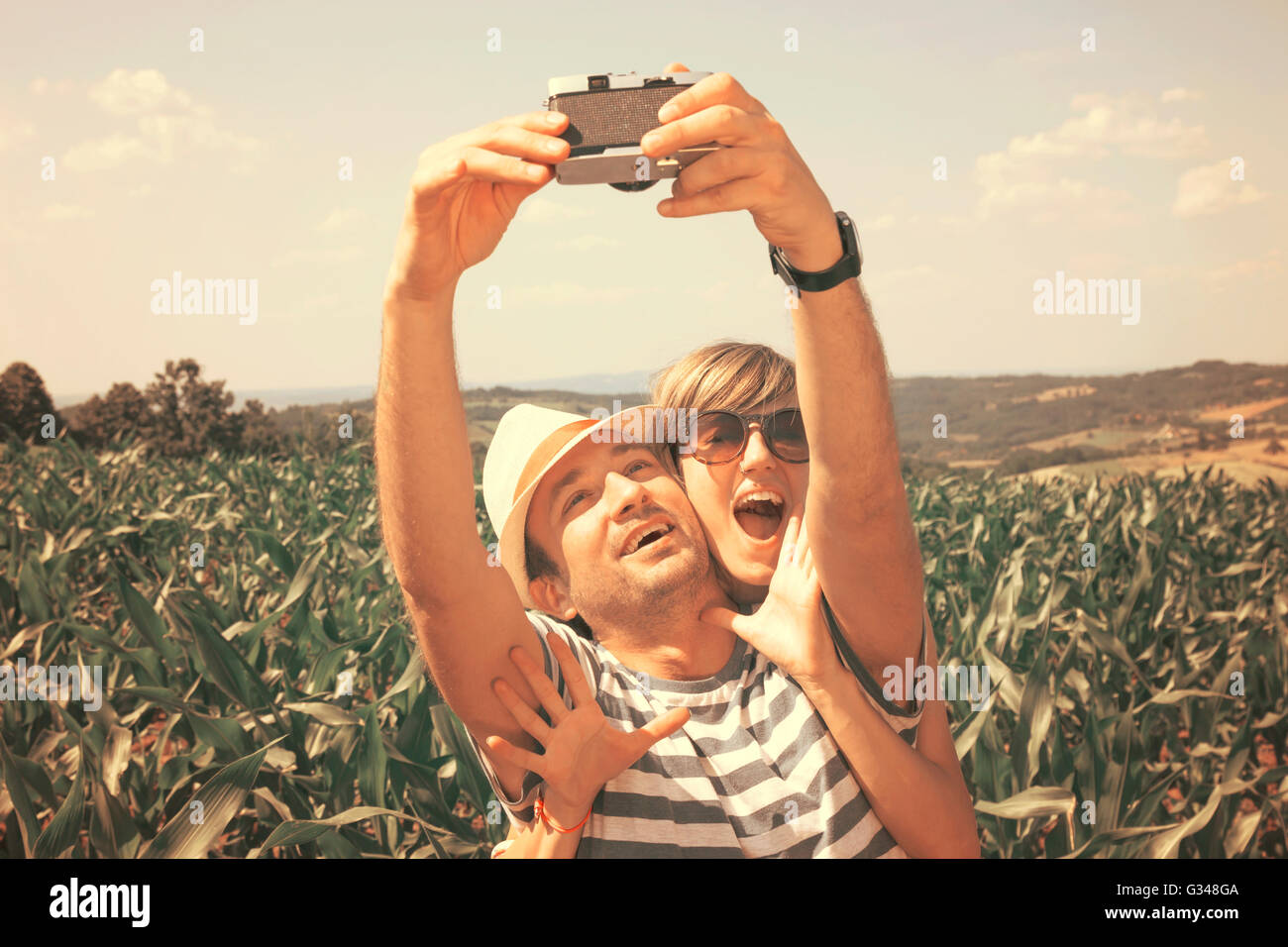 Young couple taking selfie, vintage style Stock Photo