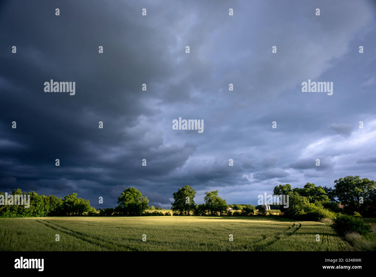 Storm clouds over the fields of La Charente in southwestern France. - Stock Image