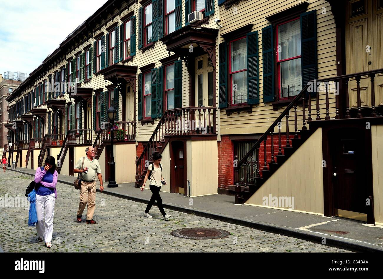 New York City: 1882 wooden row houses with stairway stoops and basement entry doors on Sylvan Terrace Stock Photo
