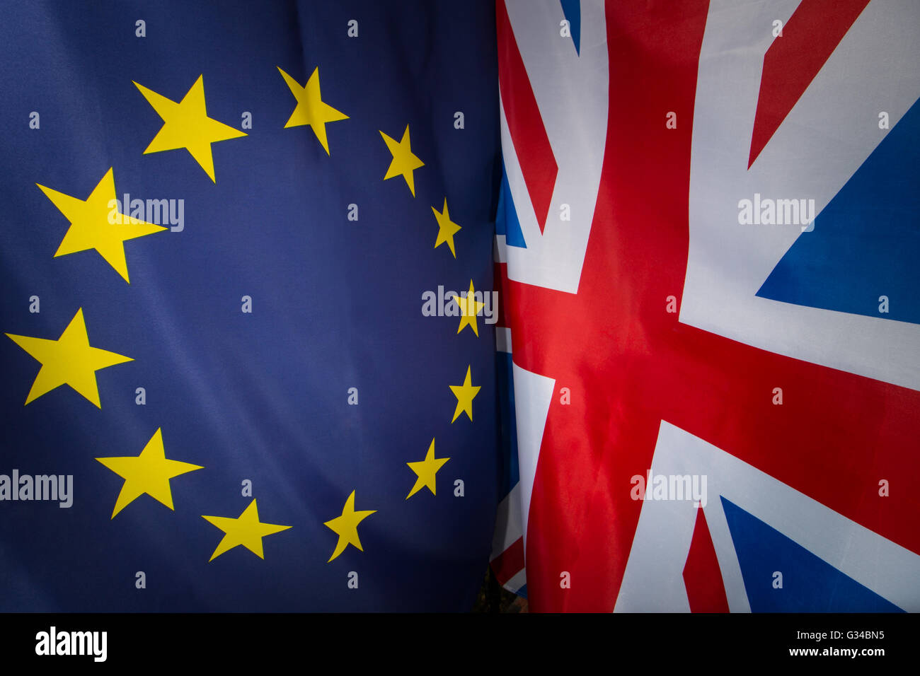 Photo of the European Flag next to the Union Jack at right angles to each other. - Stock Image