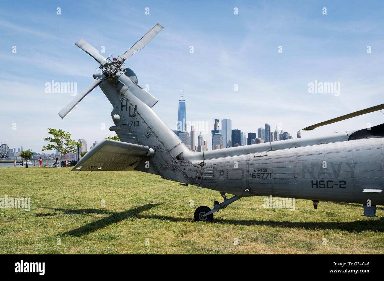 Rear rotor and tail of a US Navy Seahawk helicopter with the downtown Manhattan skyline in the background in Fleet - Stock Image