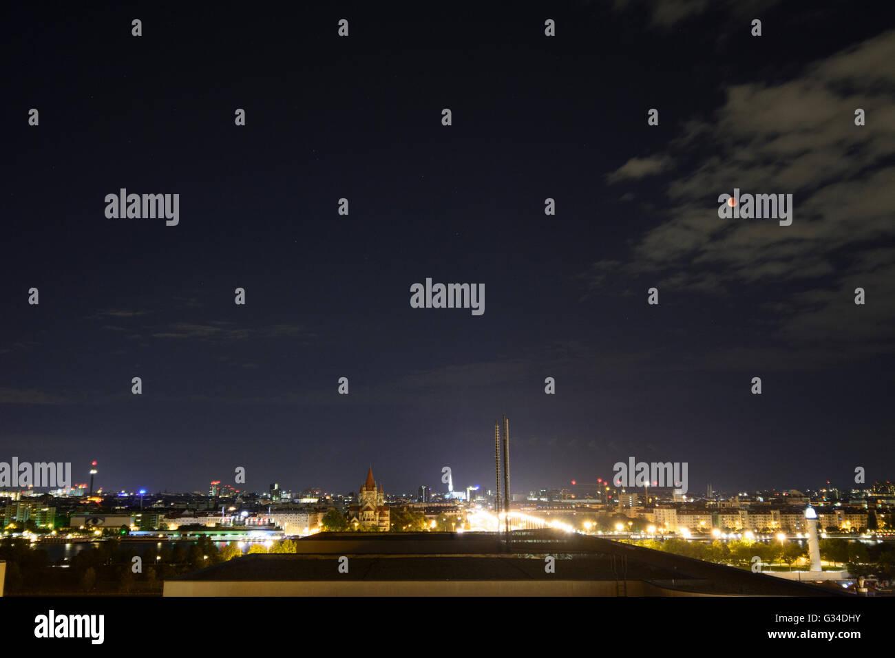 Total lunar eclipse , super moon , blood moon over the city center, Austria, Wien, 00., Wien, Vienna Stock Photo