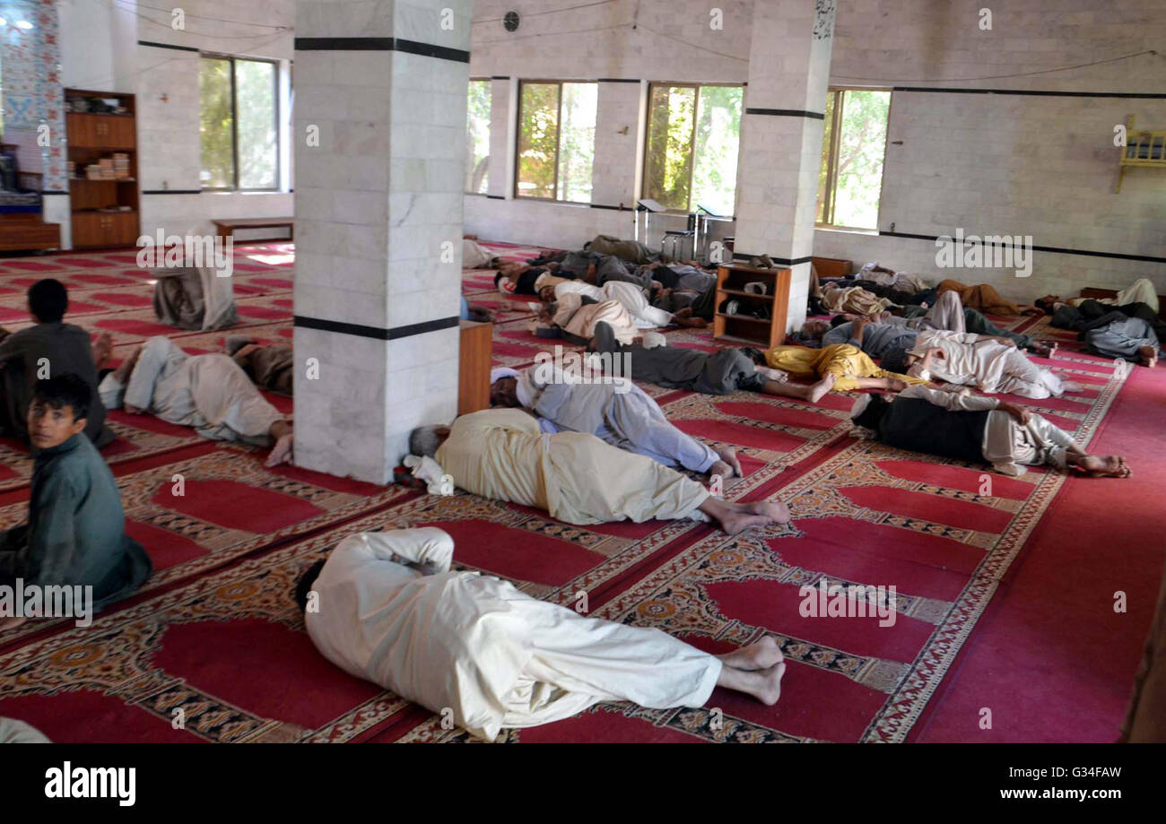 People take nap at local mosque on the first day of the Holy month of Ramadan-ul-Mubarak in Quetta on Tuesday, June - Stock Image