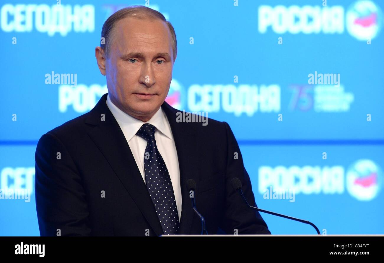 Russian President Vladimir Putin addresses staff at the Rossiya Segodnya International Information Agency or RIA - Stock Image