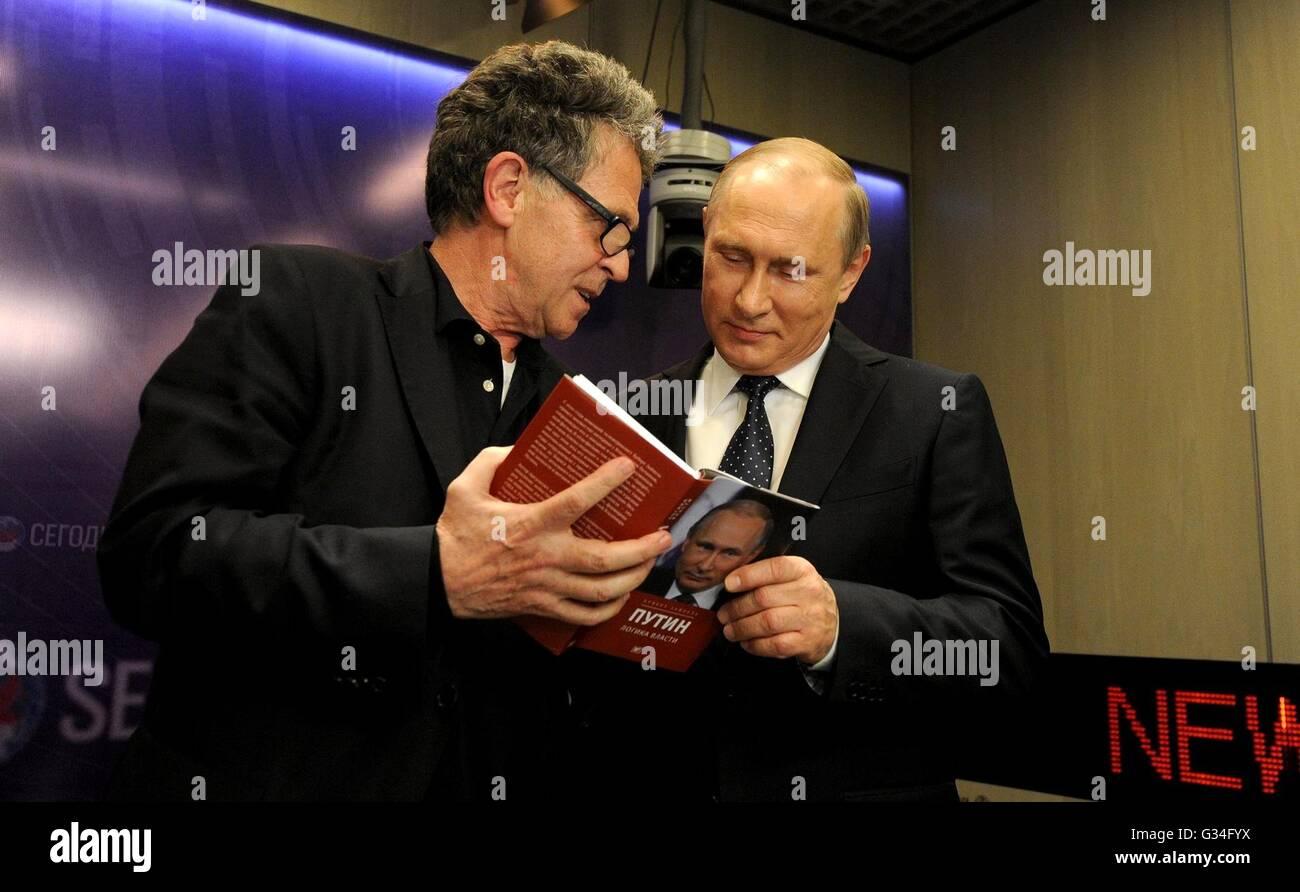 Russian President Vladimir Putin is shown the book Putin: the Logic of Power by German journalist Hubert Seipel - Stock Image