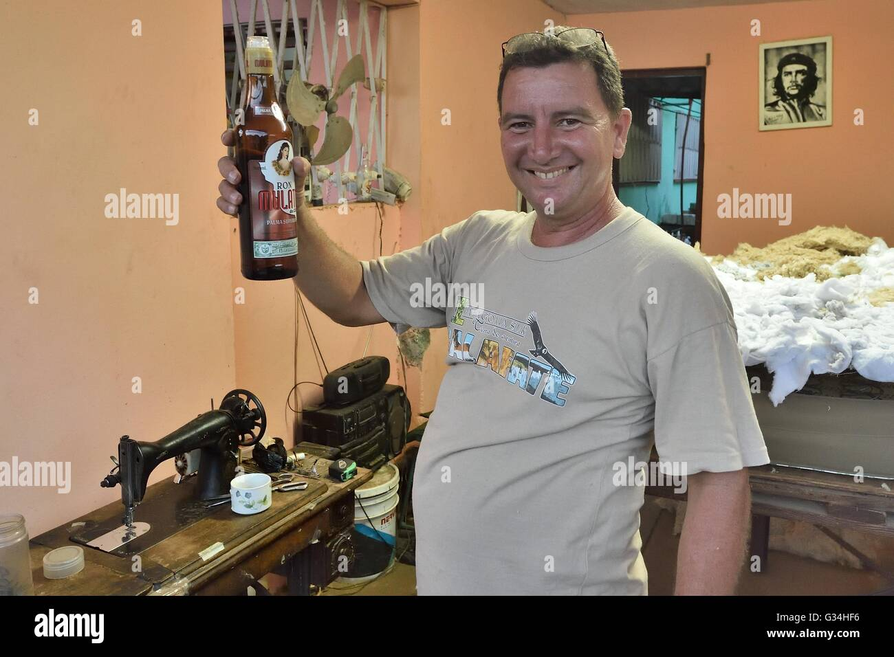 May 13, 2016 - Alamar, Alamar, Cuba - A Cuban worker enjoys some rum at a mattress shop in Alamar, the largest public - Stock Image