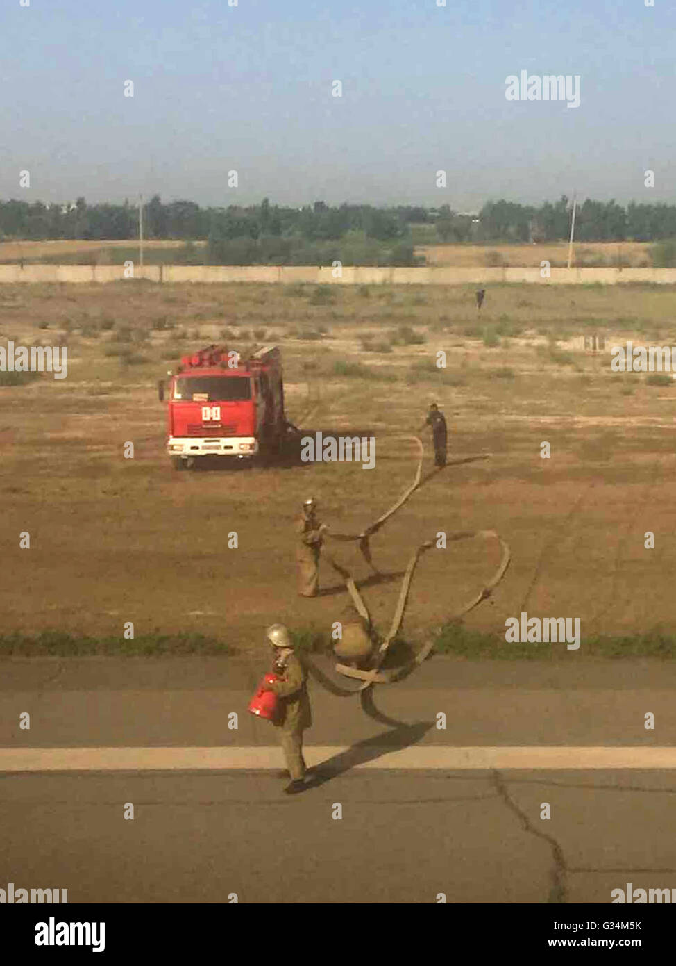 Uzbekistan. 8th June, 2016. Firemen work at the airport where the Egyptair plane made an emergency landing in Uzbekistan - Stock Image