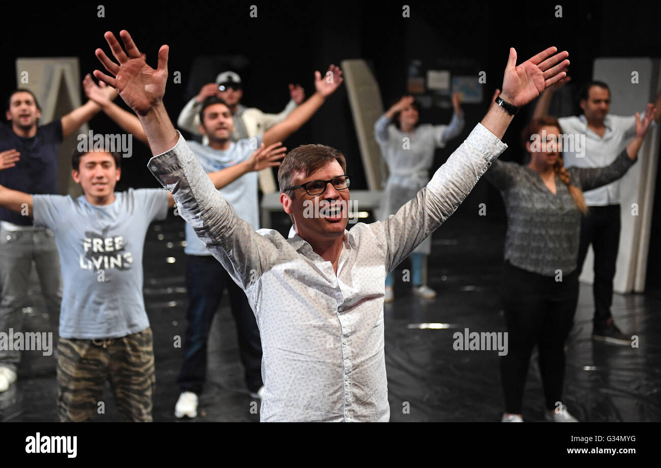 Amateur actors prepair for the final rehearsal before the staging of 'Brennpunkt: X' (lit. hot spot) in - Stock Image