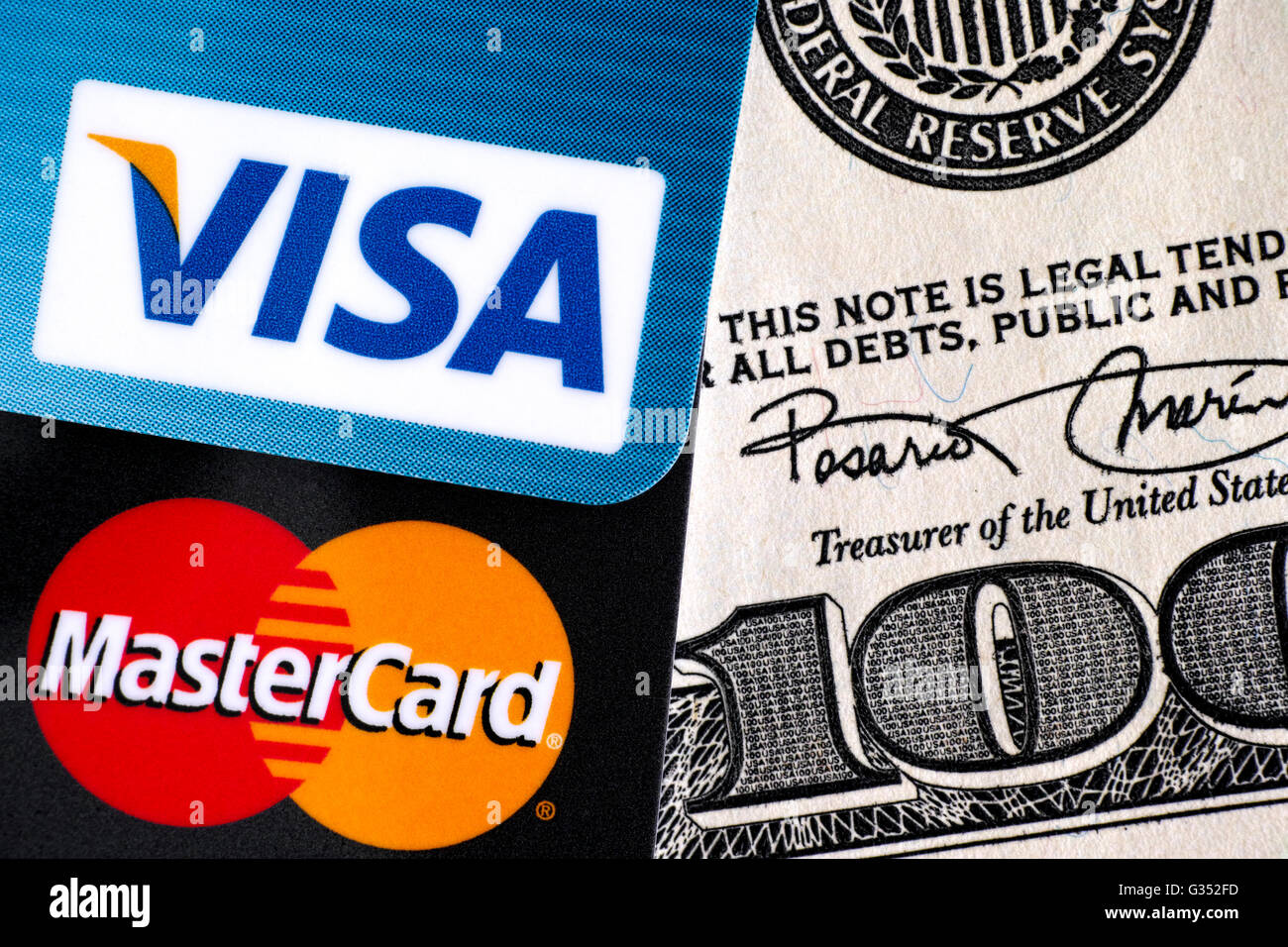 Tambov, Russian Federation - April 02, 2016 Visa and MasterCard logo on credit cards on one hundred dollar bill. Stock Photo