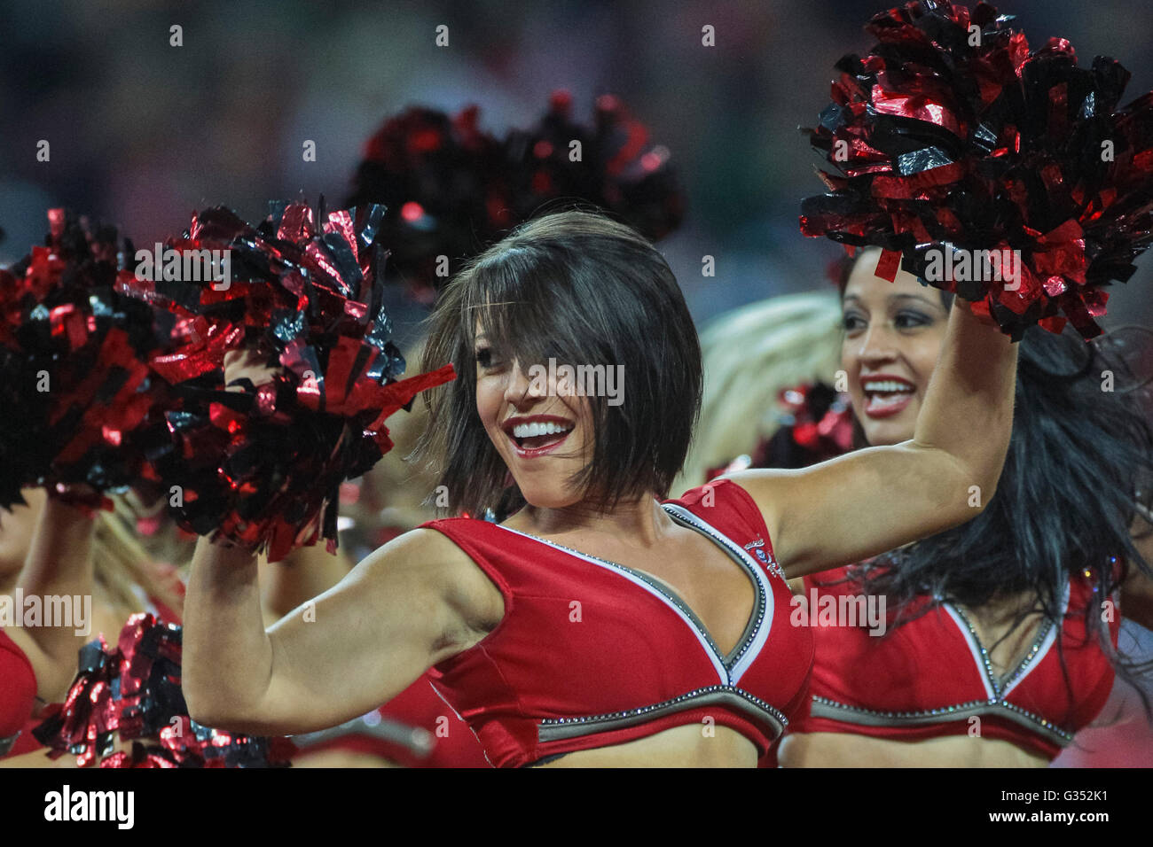 Cheerleaders of the Tampa Bay Buccaneers dance during the NFL International game between the Tampa Bay Buccaneers - Stock Image