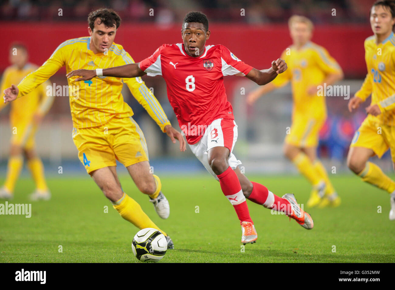 David Alaba, #8 Austria, and Muktar Muktarov, #4 Kazakhstan, fight for the  ball during the WC qualifier soccer game on October