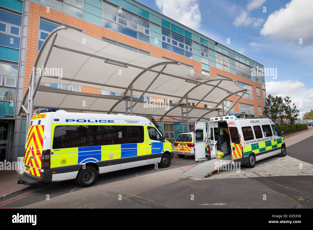 Police van and ambulance with open door at Southampton General Hospital, Southampton, Hampshire, England, United - Stock Image