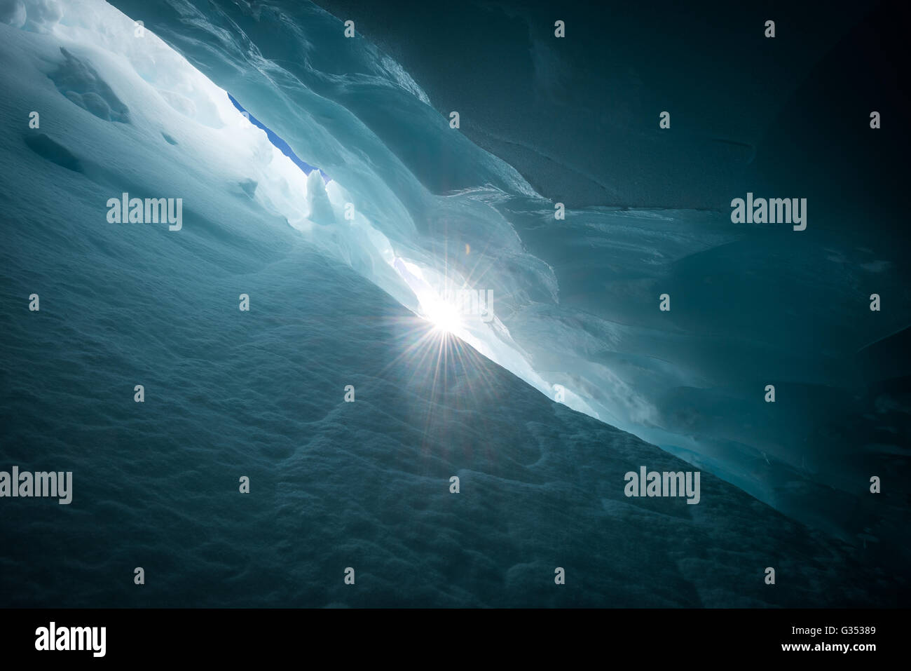 Sun star from deep within a Crevasse on Blackcomb glacier Stock Photo