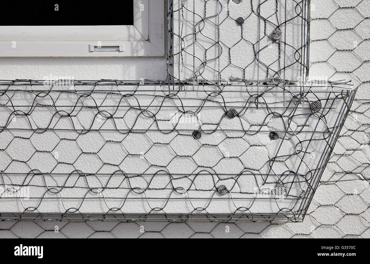 Home building industry house window frame stucco mesh installation ...