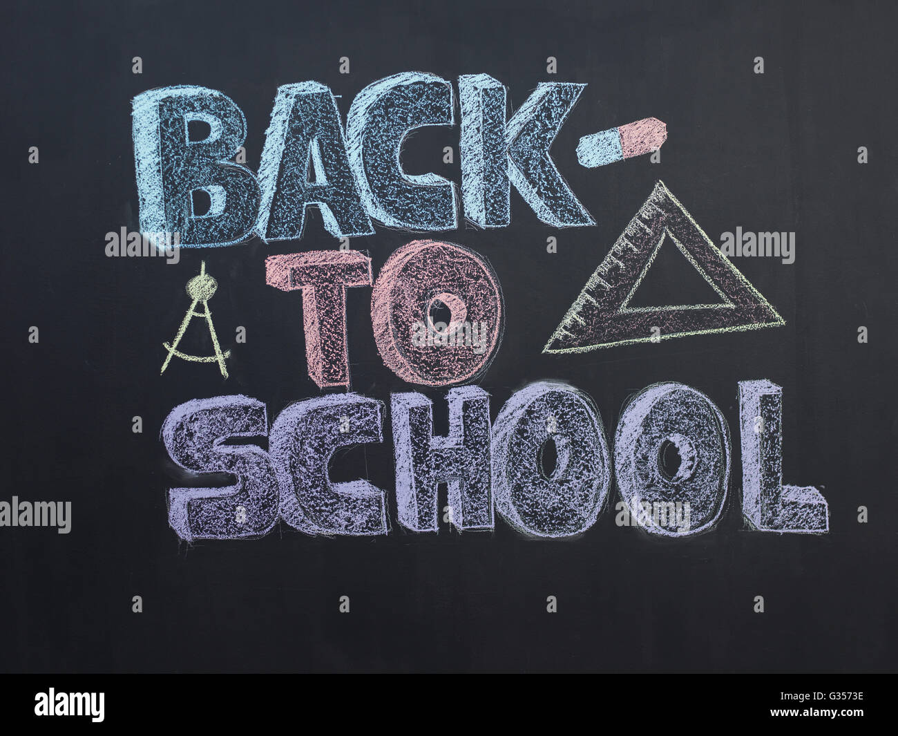 Welcome Back To School Typographical Background On Chalkboard With School Icon Elements - Stock Image