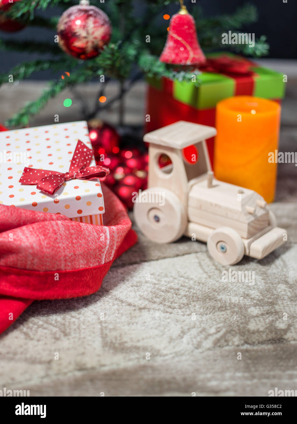 gift boxes under Christmas tree, Christmastime surprises, New Year eve concept - Stock Image