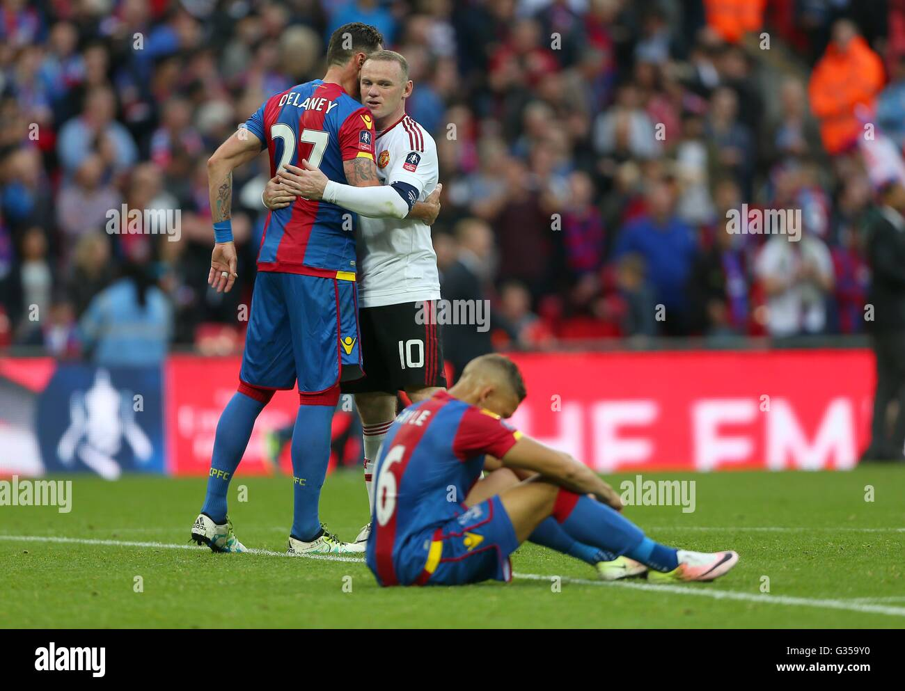 Crystal Palace's Dwight Gayle looks dejected as Wayne Rooney of Manchester United consoles Crystal Palace's Damien - Stock Image