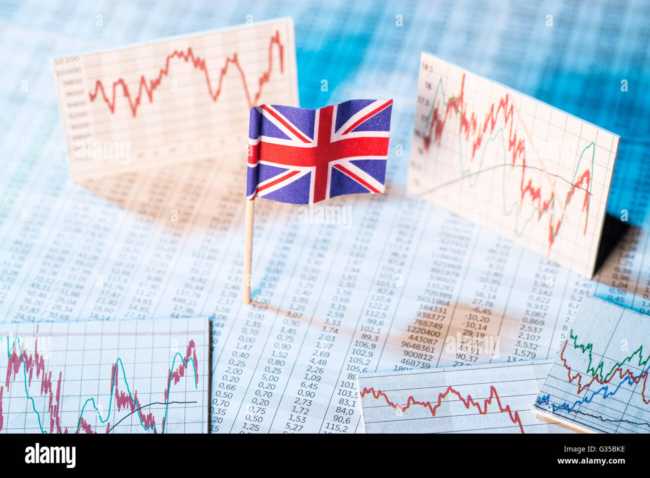 British flag with rate tables and graphs for economic development. - Stock Image