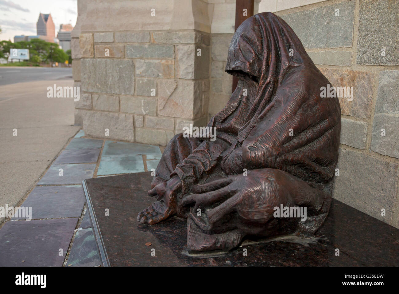 Detroit, Michigan - A sculpture called 'Whatsoever You Do' by Canadian artist Timothy Schmalz shows Jesus - Stock Image