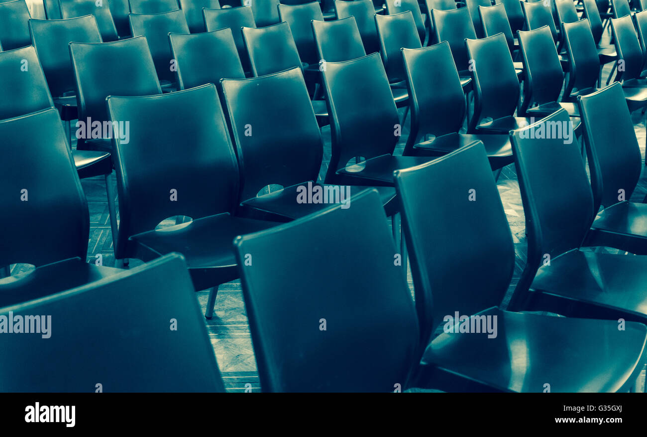 Rows of plastic chairs - Stock Image