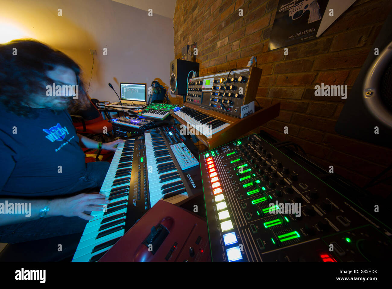 Home music studio with multiple electronic keyboards - Stock Image