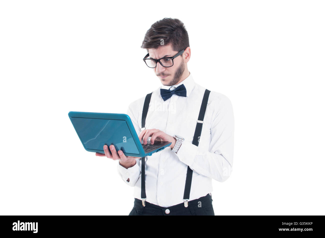 Young business man looking at his laptop with disappointment. Isolated on white background Stock Photo