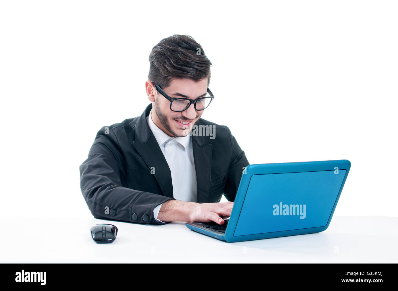 Smiling young man chatting on his laptop. Isolated on white background Stock Photo