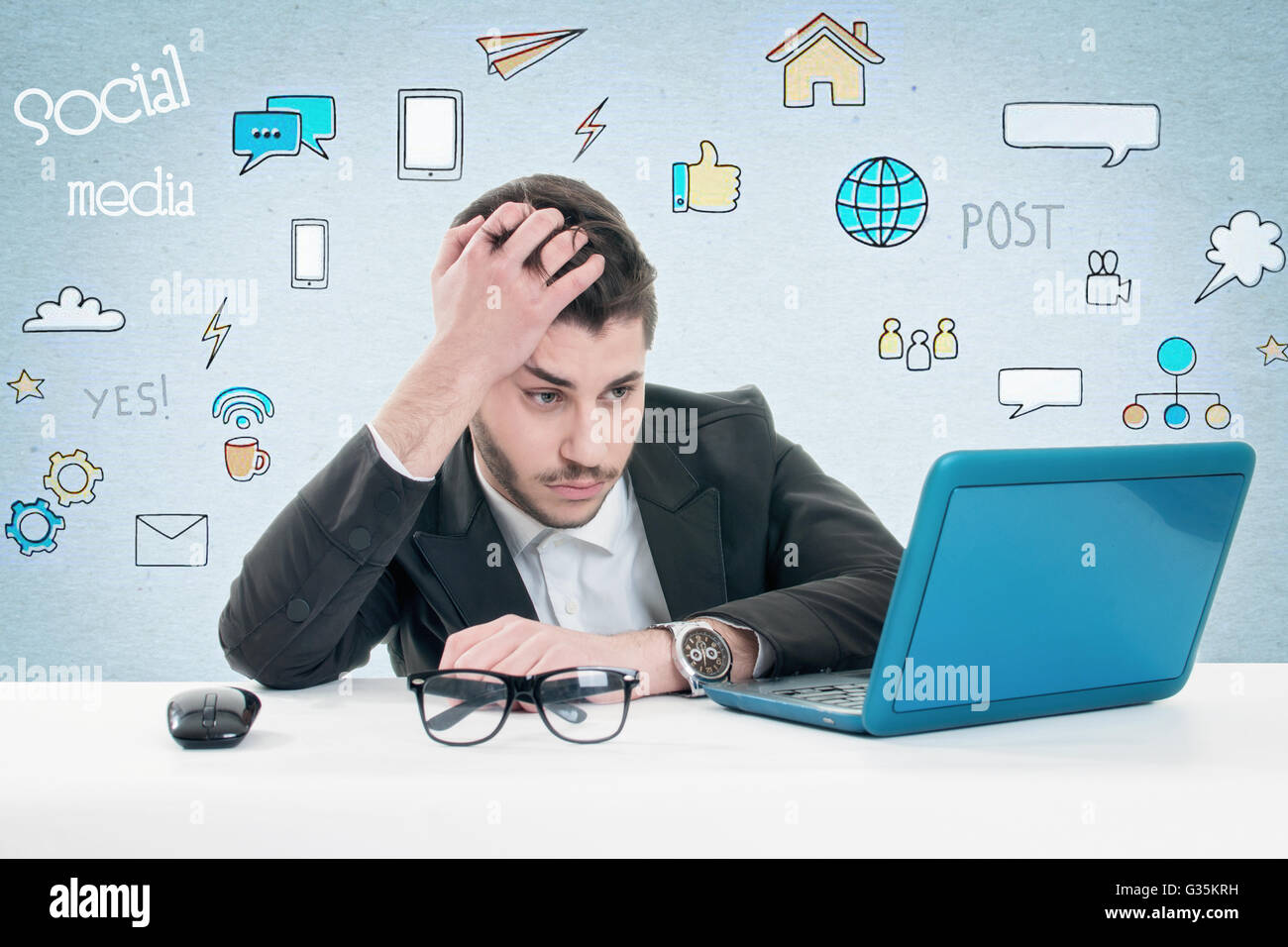 Angry furious businessman working on computer - Stock Image