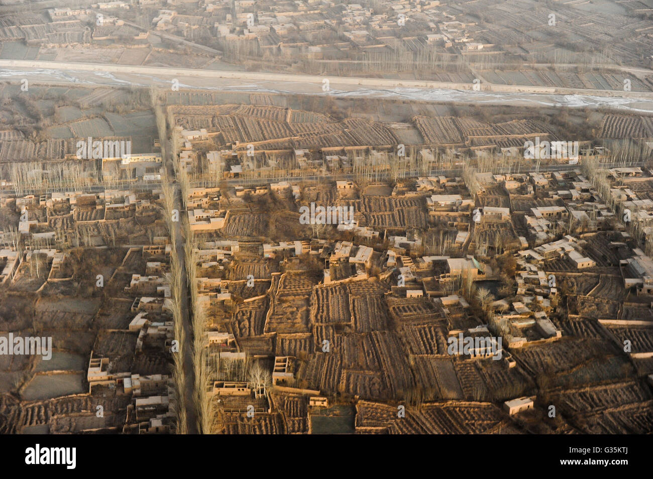 CHINA province Xinjiang, aerial view of city Kashgar and river Kashgar, where uyghur people are living, poplar tree - Stock Image