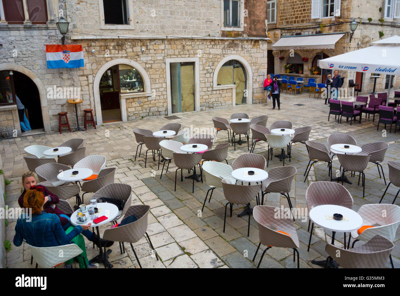 Cafe terraces, Trg Ivana Pavla II, old town, Trogir, Dalmatia, Croatia Stock Photo