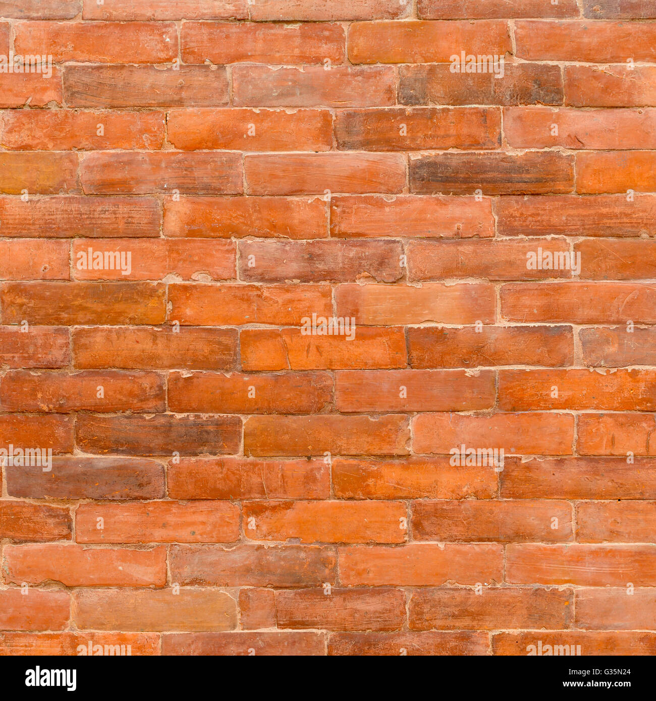 Traditional Nepalese glazed brick wall texture, perfect as a background - Stock Image